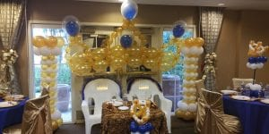 Prince theme balloon decor gold arch and columns