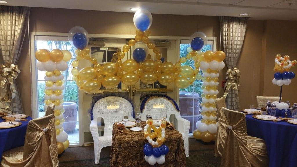 Prince theme balloon decor gold arch and columns