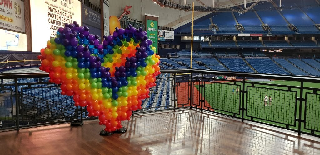 Rainbow Heart of balloons with Rays stadium in background
