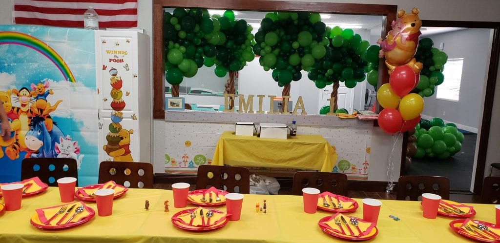 Pooh themed balloon decor for first birthday party