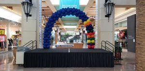 Balloon Arch back to school event at westshore mall blue and primary colors