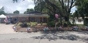 Balloon decorations on fence and front yard decorations