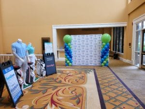 FrankCrum Golf Tournament balloon column decorations on backdrop