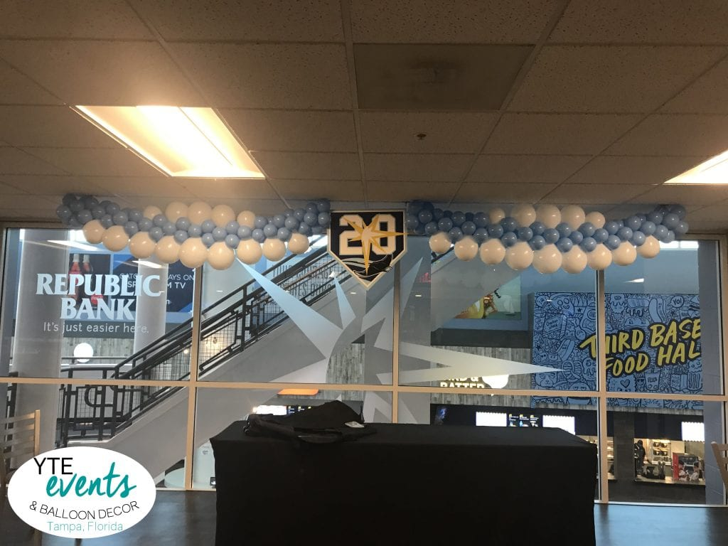 20th anniversary for Tampa Bay Rays with logo balloon garland over DJ table
