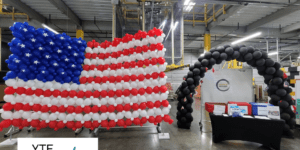 American flag balloon wall and black balloon archway made for a Memorial Day event.