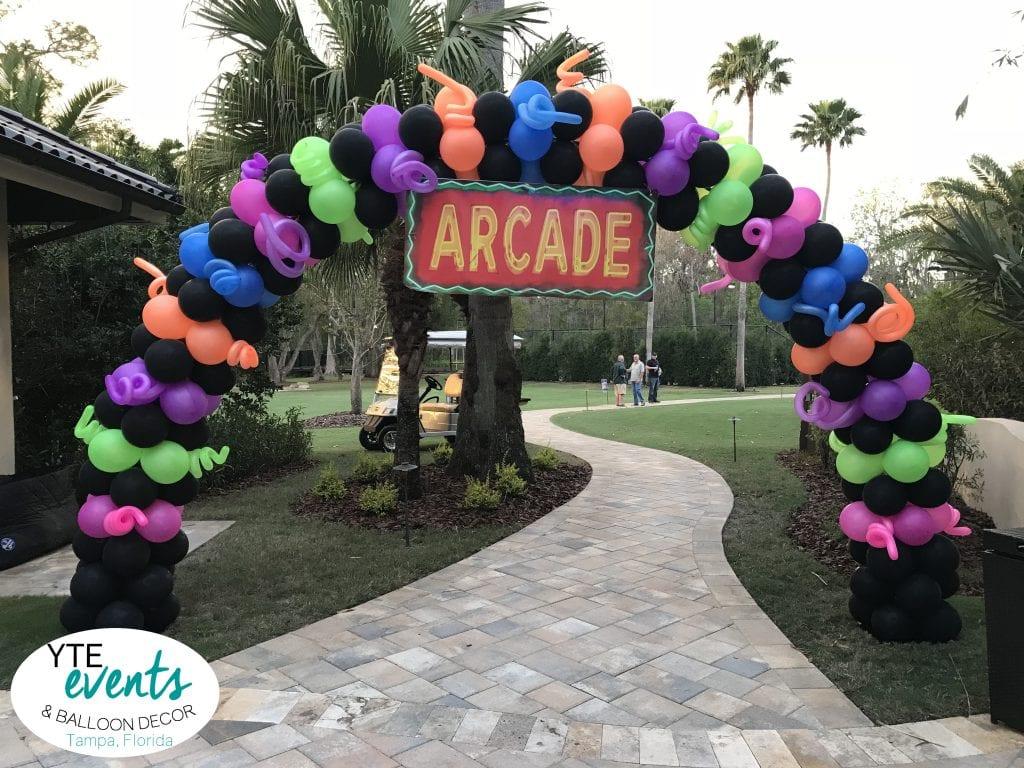 Arcade Themed neon arch for event black pink green orange blue purple blacklight