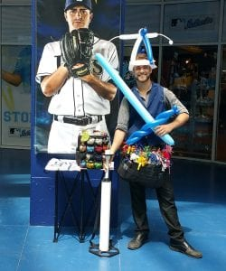 balloon hat and balloon sword with balloon artist at Rays Baseball Game