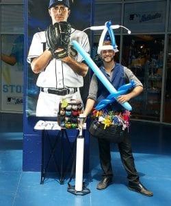 balloon hat and balloon sword with balloon artist at Rays Baseball Game