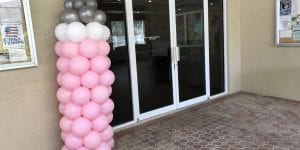 Baby shower bottle balloon column sculpture in pink for event