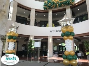 homecoming Balloon Columns for USF Sarasota and a balloon drop with gold white green