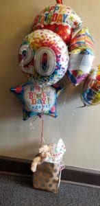 Balloon bouquet delivery with teddy bear gift and candy for the birthday girl celebrating her 20th birthday