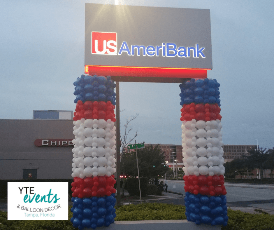 Balloon column sculptures to compliment a sign for a branch of US AmeriBank.