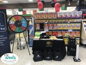 Balloon twisting for boars head and publix event in Tampa Florida
