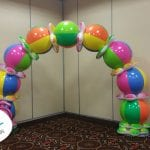 Beach ball themed balloon arch for event