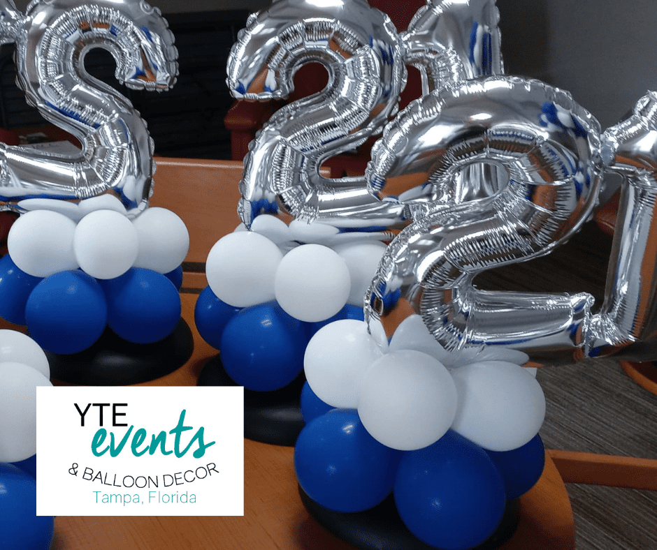 Blue and white balloon centerpieces with foil balloon toppers for Hudson FL Kostreles event