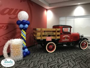 Tampa Budweiser corporate event with beer mug sculpture and balloon column and truck Tampa