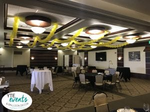 Ceiling balloon decorations for corporate event