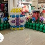Children's dance area for easter event with egg sculpture and balloon dance floor
