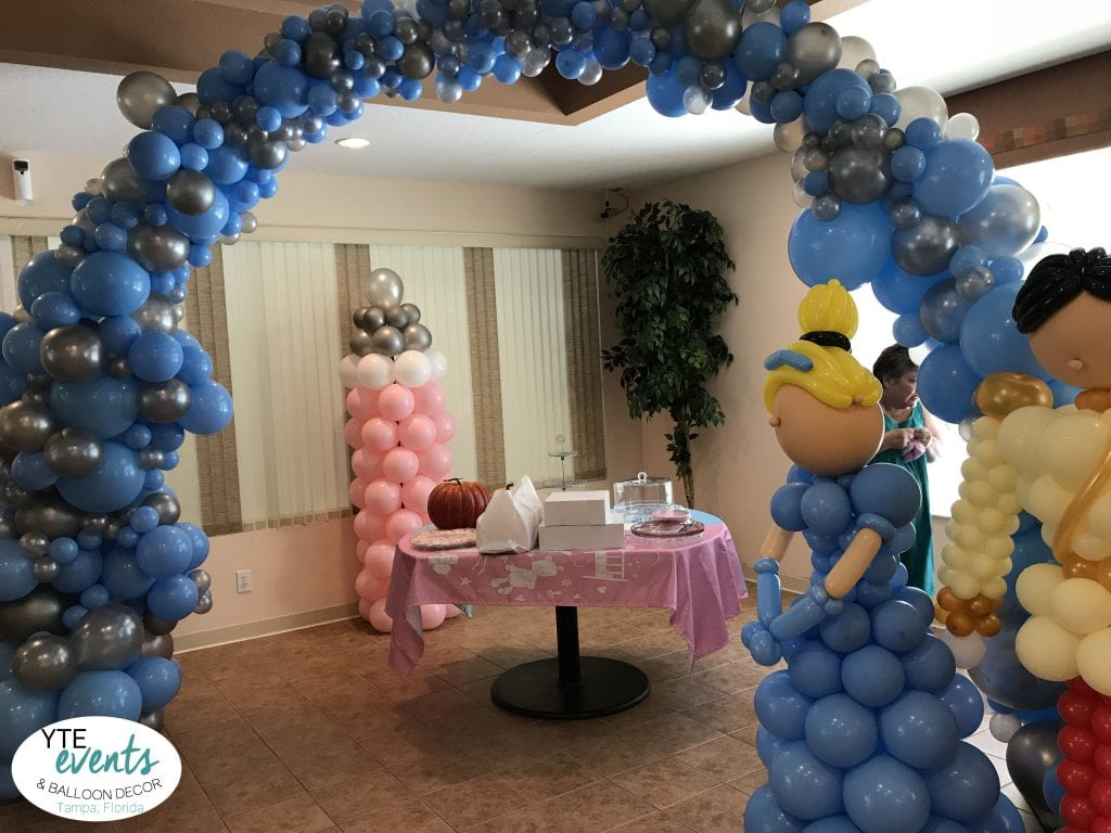 Cinderella themed baby shower event with prince and princess and organic balloon arch silver and blue