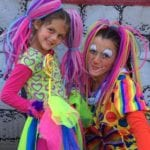 Colorful Tampa Clowns in bright colorful outfits