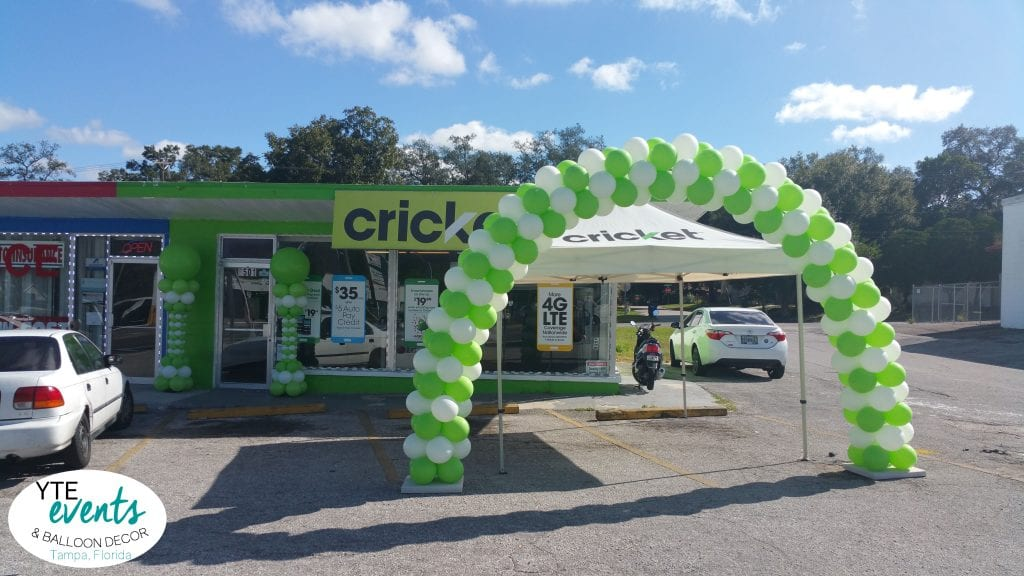 Cricket grand opening balloon arch and columns