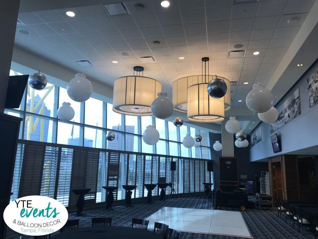 Elegant Ceiling balloon decorations for corporate event at Amalie Arena