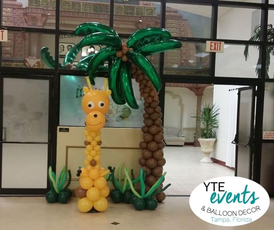 Giraffe and palm tree balloon sculptures at Indian Cultural Center Tampa Florida