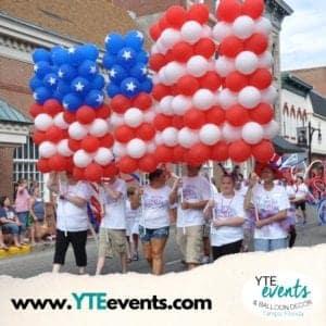 Group balloon column sculpture of the American Flag for a parade Tampa Florida