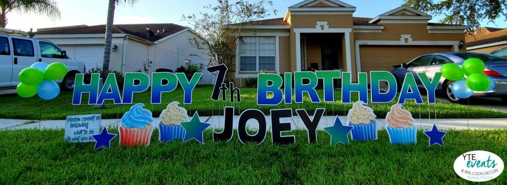 Happy Birthday 7th Party Joey Yard Sign cupcakes and green letters