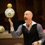 Juggling soccer balls at event with Bill Berry Entertainment