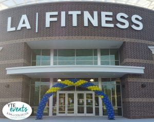 LA Fitness Balloon Decorations with blue and yellow arch