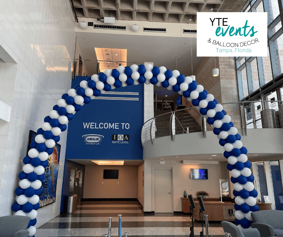 Large blue and white balloon arch at Amalie Arena in downtown Tampa.