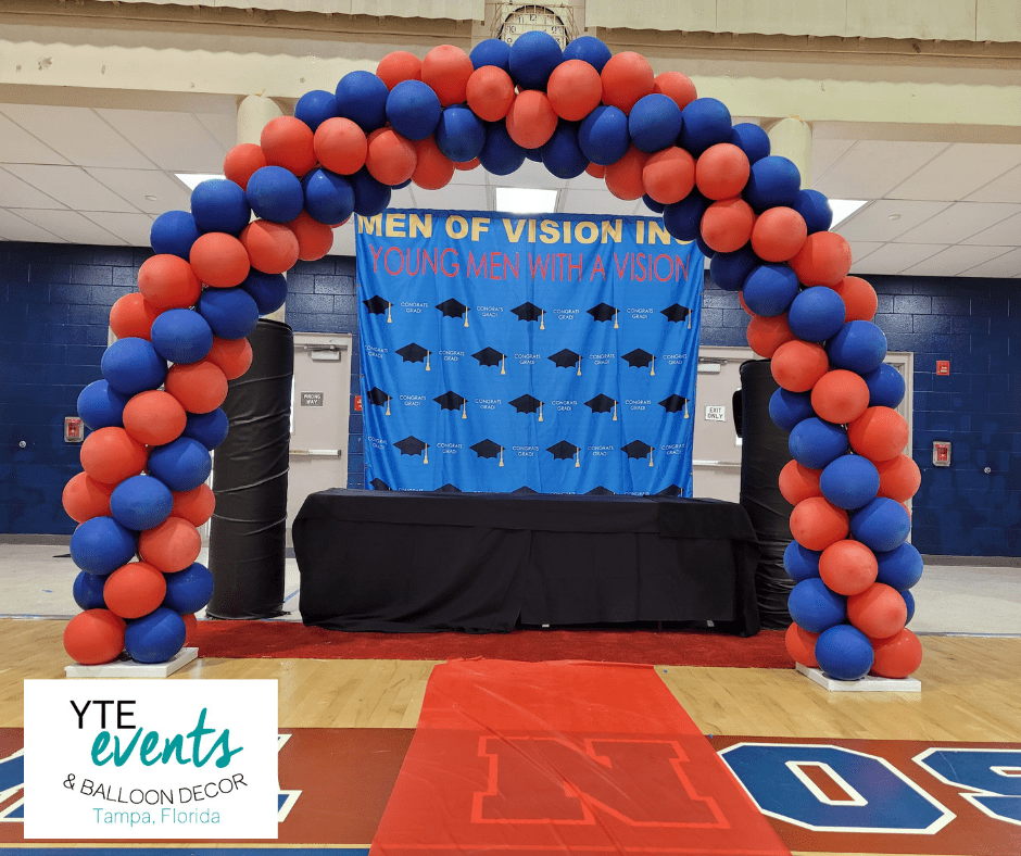 Leadership academy graduation featuring a balloon arch in school colors.