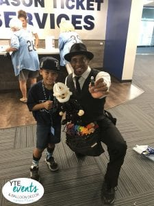 Master Balloon Artist makes a lego man out of balloons at the Tampa Bay Rays Game