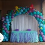 Mermaid colored arch with under sea creatures