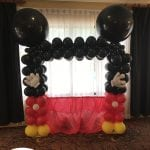 Mickey Mouse themed balloon decor backdrop for photo opportunity