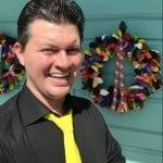 Mr Fudge balloon artist at event Tampa florida with balloon wreaths on door