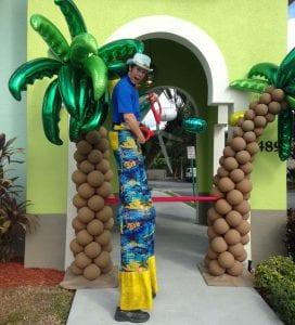 hawaiian luau stilt walker with balloon palm trees