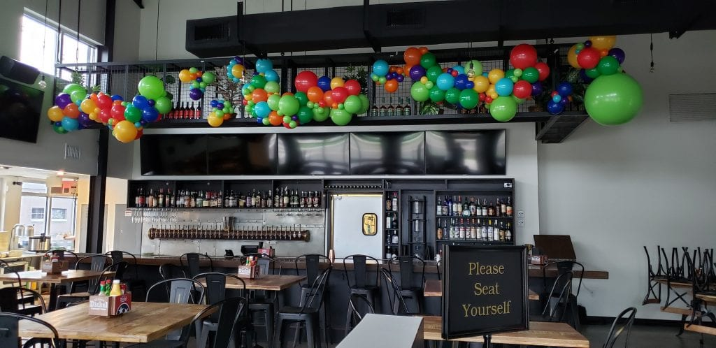 Organic Balloon Decorations over the bar for restaurant opening