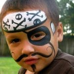 Boy face painted as a pirate for a birthday party