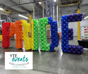 Pride balloon sculpture using rainbow balloons to create each separate letter for Amazon in Ruskin, FL.