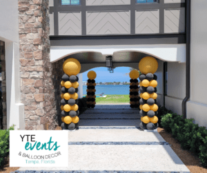 Private graduation event that had yellow and black balloon columns.