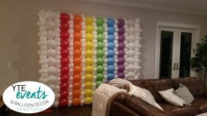 Rainbow balloon wall decorations for private birthday party