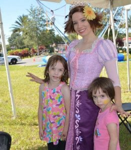 Rapunzel princess at event with kids