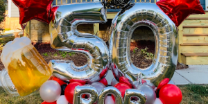Rob turns 50 balloon decor yard display marquee with beer red stars