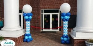 School ribbon cutting event columns