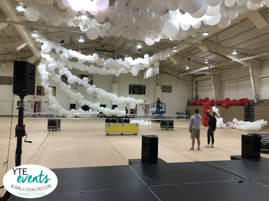 Setup before the event ceiling balloon decorations organic