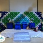 Stage backdrop wall for baby shower event with blue teal white and green