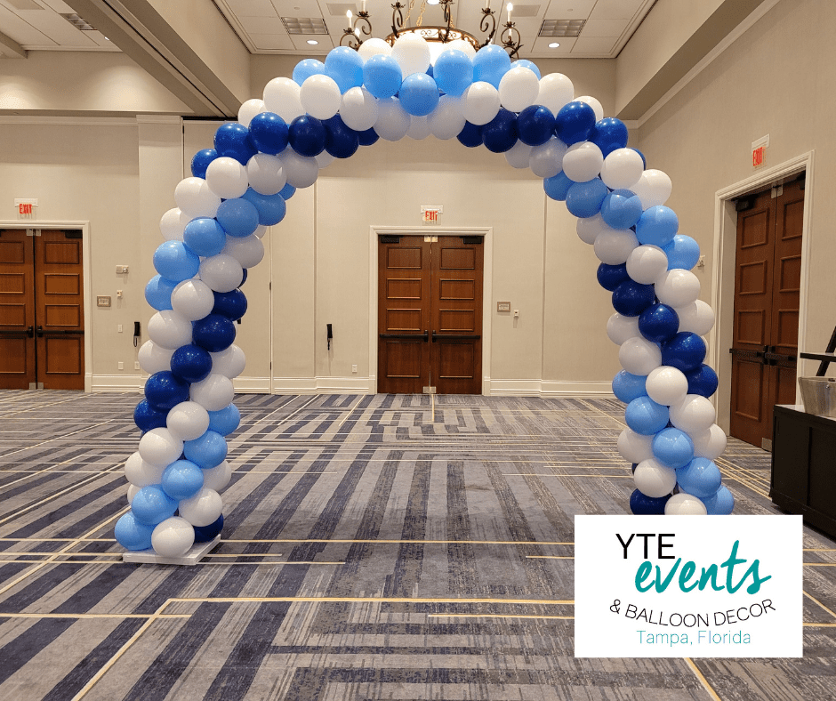 Tri-color spiral balloon archway made for a speaking event at the Renaissance Hotel.