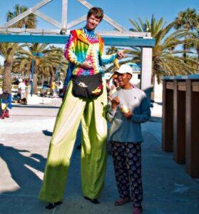 tie dye stilt wlaking entertainer for clearwater festival